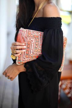 Off the shoulder + embroidered clutch.