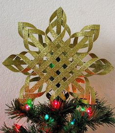 Woven Paper Tree Topper ~ Our tree topper died last year, I think I may have found a replacement!