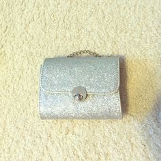 Small sparkly silver clutch Very cute sparkly clutch, perfect for school dances, formals, and proms. Adjustable chain that allows you to put it over your shoulder. In great condition, only used a few times. Bags Clutches & Wristlets