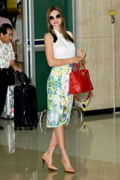 Miranda Kerr wearing Miu Miu Culte Sunglasses, Equipment Sleeveless Signature Blouse, Lanvin Pointed-Toe Asymmetric Leather Pumps, Erdem Spring 2012 Rtw Criona Skirt and Samantha Thavasa Lock Red Leather Bag.
