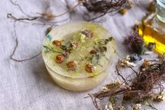 Homemade soaps with loofah and dried flowers.  www.etsy.com/shop/Lidulula