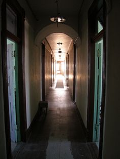 The hotel hallway at the historic McAdam Railway and Hotel, with brilliant sunshine providing a dazzling effect. Hotel Hallway, Places, Hotel Corridor, Lugares