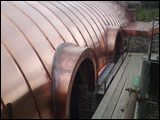 Curved barrel-vaulted copper roofs for barn conversion Copper Roof, Metal Roof, Barrel, Wood, Madeira, Copper Ceiling, Woodwind Instrument, Timber Wood, Barrels
