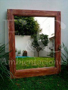 Vieja ventada, reciclada y transformada en espejo. Patinada y avejentada en color bordo y derivados. Conserva herraje original.