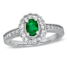 Oval Emerald and 1/4 CT. T.W. Diamond Scallop Frame Engagement Ring in 14K White Gold