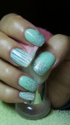 Turquoise (pale green) and white nails with glitter