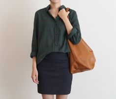 I love this business casual look. A+ on the dark green plaid with navy pencil skirt.
