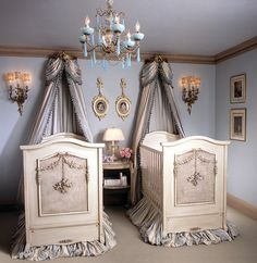 These French inspired cribs with their silk striped skirts and crown canopies are set up in a nursery for twins, but wouldn't one be just as perfect? Traditional armoires, chests and upholstered chairs would fit well with these cribs and stand the test of time as a lucky baby or babies grow older.