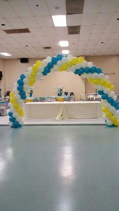 Turquoise white yellow balloon arch