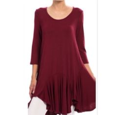 "SCOOP NECK FLARED TUNIC IN BURGANDY Soft and flirty flared tunic top. Perfect over your favorite jeans or leggings. Fabric has good stretch. 95% Rayon; 5% Spandex. Medium fits sizes 8-10; Bust 36""-38""; Length - 34"". TRADESPAYPAL Rouge Tops Tunics"