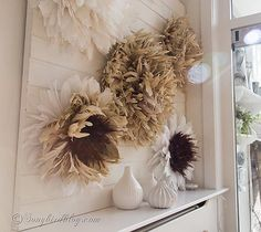 neutral colored juju hats mantel decoration via Songbirdblog