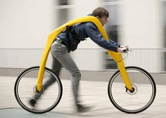 You strap yourself to the top bar and, suspended, run or walk this bicycle.  fun!!!