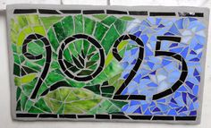 Etsy listing at http://www.etsy.com/listing/152721877/custom-glass-mosaic-home-address-sign