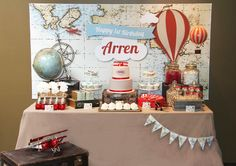Upon arrival, guests were greeted with a fun hot air balloon photo booth, where 'lil travelers could sit in the basket of a hot air balloon. After lunch, guests headed over to a travel themed dessert table.