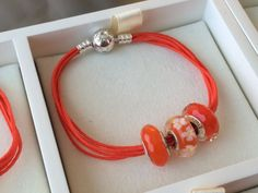PANDORA Orange Multi-Strand Bracelet with Coordinating Faceted/Floral Murano.