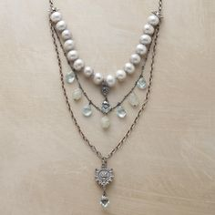 AQUITAINE NECKLACE  Adriana Goddard's multi-strand pendant necklace strikes a regal balance between Victorian grandeur and modern sensibility. Handcrafted in the USA of freshwater pearls, blue quartz, aquamarine and sterling silver. Lobster clasp.