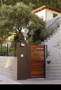 nice modern wood and steel gate entry_Blasen_Landscape_Architecture-