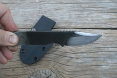 Small EDC clip point file knife. Good for all around cutting tasks and last ditch self defense.