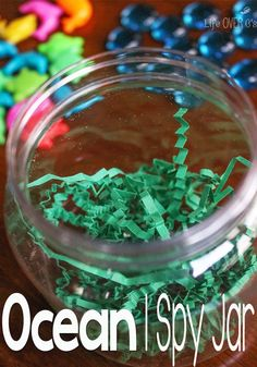 "Just a few minutes and a few supplies is all you need to make this fun ocean-themed I Spy jar! (complete with ""seaweed""!)"
