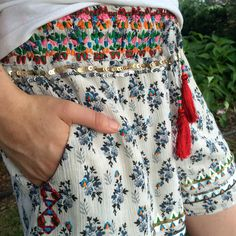 Printed and embellished cotton gauze shorts.