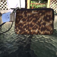 Coach Wristlet NWT Coach Madison Ocelot Faille Wristlet.  This wristlet is Stunning! Still has the tag and it comes with the care card. Coach Bags Clutches & Wristlets