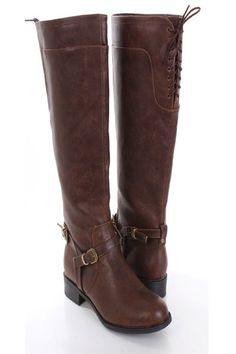 Be comfy yet stylish this season with these fashionable riding boots! They will go perfect with your favorite sweater dress or skinnies! Make sure you add these to your closet, it definitely is a must have! The features include faux leather upper with straps and buckle accents, back lace up design, round closed toe, slip on design, stitched detailing, smooth lining, and cushioned footbed. Approximately 1 1/2 inch low heels, 15 inch circumference, and 15 inch shaft.