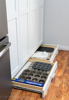 Love this for those long cooking aids that don't quite fit in the cabinets. Great for pans or a roaster, if it was a little deeper. Toe Kick Drawers for additional storage below cabinets!