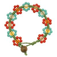 Spring green hemp is knotted with Czech glass beads to create adorable little daisies. A round wood bead serves as the perfect clasp.  Video on site.