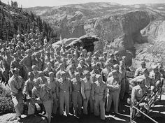 In this 1943 photograph taken by Ansel Adams, U.S. Army soldiers visit Glacier Point. Adams spent much of the 1930s-'40s documenting many of Yosemite's significant structures and people for the park and the park's concessionaire at the time.