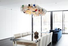 The Invisible Chandelier Reuses Hundreds of Burnt Out Bulbs In One Brilliant Luminaire