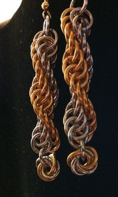 These handmade double spiral earrings are made out of gold and rhodium.  And don't worry, they will never come unwound :)