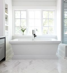 Chic white master bath boasts a gleaming white pedestal tub and a gooseneck tub … – Marble Bathroom Dreams Master Bath Remodel, Diy Bathroom Remodel, Bathroom Interior, Bathroom Makeovers, Interior Livingroom, Bathroom Renovations, Simple Bathroom, Modern Bathroom, Shower Bathroom