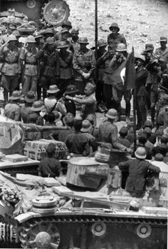 21 April '41: Rommel awarded with the Italian Medal for bravery in silver. Few Panzer III Tropen in the foreground. Rommel's leadership of German and Italian forces in the North African campaign established him as one of the most able commanders of the war, and earned him the appellation of the Desert Fox. He is regarded as one of the most skilled commanders of desert warfare in the conflict.