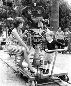 "Gina Lollobrigida and her son, Milko Skofic Jr., ride the camera trolley on the set of ""Come September"" (1961)"