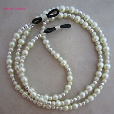 Elegant ivory pearl and silver eyeglass chain for reading glasses.