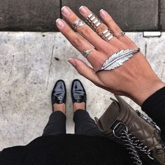 Chanel loafers + silver rings + black skinny jeans