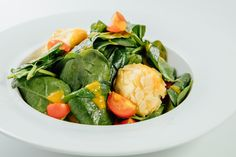 Spinach salad and Chevre cheese roasted in almond crust and mango puree