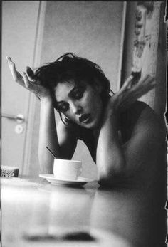 Monica Bellucci Sitting with coffee wondering why the universe hasn't blown up.