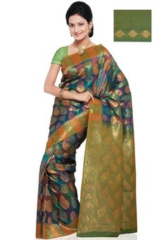 Turquoise green and magenta shot tone zari woven art silk saree. As shown in the inset green art silk blouse fabric will be made available which can also be customized from 32 to 42 inches, blouse fabric draped on the model is for photography purpose. (Slight color variation is possible.) data-pin-do=