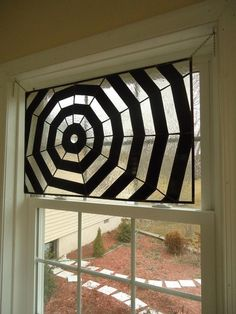 neat stained glass spider web panel