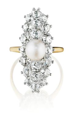 This fabulous navette-shaped diamond ring features plenty of lovely old-cut diamonds and a natural pearl set in 14k yellow and silver-topped gold. (Via Phillips.)