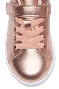 Glittery trainers: Trainers in shimmering metallic imitation leather with a hook and loop tab at the top, elasticated lacing at the front and a loop at the back. Mesh linings and insoles and rubber soles.