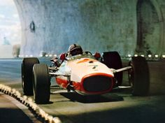 John Surtees on Honda through the tunnel in Monaco.