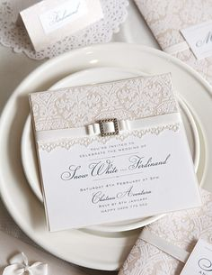 Love the lace design on the invite with the font but no belt across