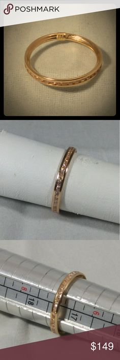 14kt Rose Gold Eternity Ring Size 7 14kt Rose Gold Eternity Ring with Brilliant Round Diamond Simulant stones. These stones are just as brilliant if not more Brilliant than Natural Diamonds. They are Channel set to keep safe and looking stunning for many years to come. Be a part of something Endless! Jewelry Rings