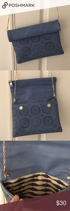 StitchFix Urban Expressions purse slate blue Slate blue fold over clutch/purse from Stitch Fix/ Urban Expressions. Long gold chain, removable. Used once. Two main openings, additional zipper and pocket inside. Laser cut design on the front. Gold hardware. Urban Expressions Bags Crossbody Bags