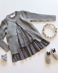 Must have pieces for a stylish little girl's wardrobe. Grey knitted cardigan with sweet shell buttons and floral babydoll dress that looks adorable layered over knitted tights and worn with lace up leather brogues. Knitted Tights, Stylish Little Girls, Leather Brogues, Girls Wardrobe, Babydoll Dress, Baby Wearing, Frocks, Baby Dolls, Charcoal