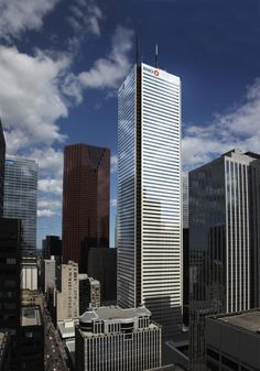 First Canadian Place Rejuvenation. With a white marble exterior since 1975, re-cladding of the exterior in glass was completed in 2013.