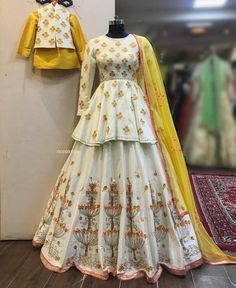 White embroidered wedding lehenga for mom and son set. Click on picture to see Ricco India lehenga price. #Frugal2Fab
