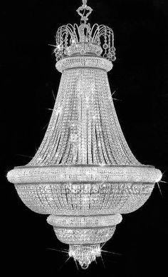 18 light Crystal entryway/foyer chandelier. Back in an era of Hollywood where glam and elegance just was.